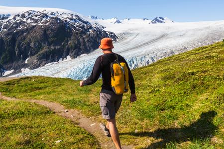 solitude: Hiker in Exit Glacier, Kenai Fjords National Park, Seward, Alaska Stock Photo