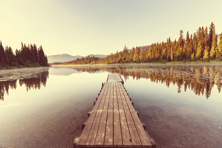 jetty: Lake landscape with the wooden jetty Stock Photo