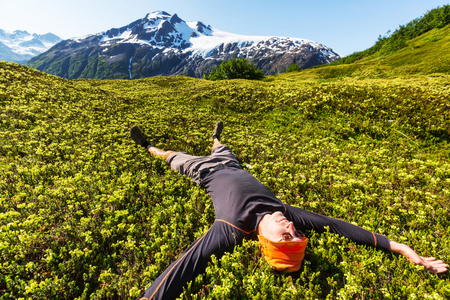 people relaxing: Relaxing backpacker  in mountains.    Stock Photo