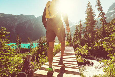 Hiking man in the mountains Stock Photo