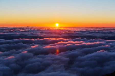 sunset clouds: Beautiful sunset on the hill above clouds