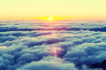 Beautiful sunset on the hill above clouds Stock Photo - 45500492