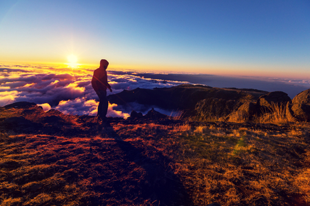 above the clouds: Beautiful sunset on the hill above clouds