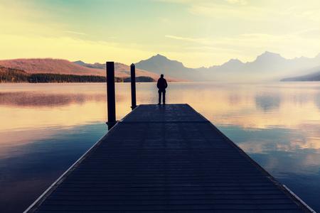 Man on mountains lake