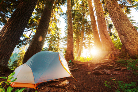 sunrise mountain: Tent in the mountains Stock Photo