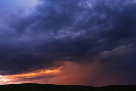 dark skies: Sunset clouds Stock Photo