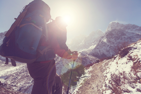 man climbing: Hiker in Himalayas mountain. Nepal Stock Photo