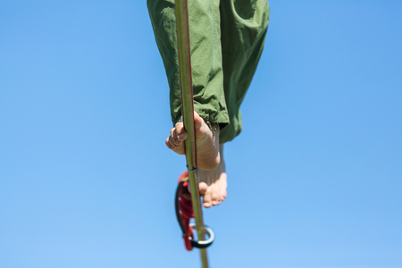 barefooted: Slacklining is a practice in balance Stock Photo
