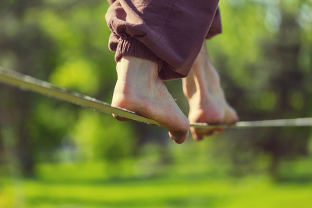 Slacklining is a practice in balance Stock Photo