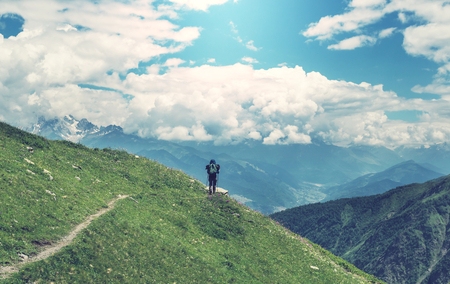 backpacker: Backpacker in mountains