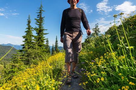 persona caminando: Hiking man in the mountains Foto de archivo