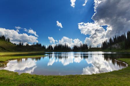 placid water: Image lake and Glacier Peak in Washington, USA Stock Photo