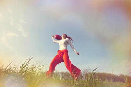 exult: Happy girl on the grassland Stock Photo