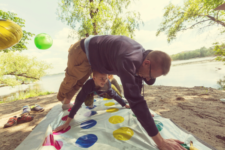twister: Kids playing twister game outdoors Stock Photo