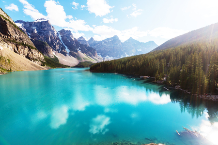 deep blue: Beautiful turquoise waters of the Moraine lake with snow-covered peaks above it in Banff National Park of Canada