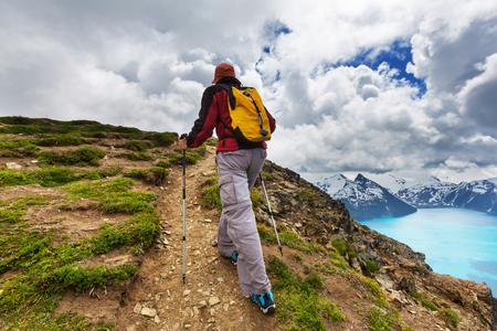 tall: Hiking man in the mountains Stock Photo