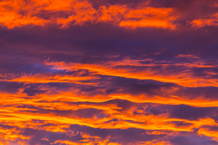 storm clouds: Unusual storm clouds at sunset. Bright red and orange colors of the sky. Suitable for background. Stock Photo