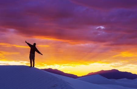 desert sand: Hiker in sand desert. Sunrise time. Stock Photo