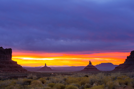 gods: Valley of the Gods rock formation with Monument Valley at sunrise