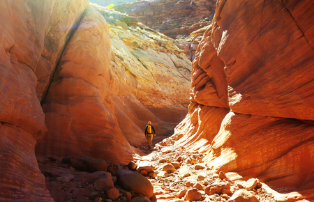 Happy Canyon fantastic scene. Unusual colorful sandstone formations in deserts of Utah are popular destination for hikers. Stock Photo