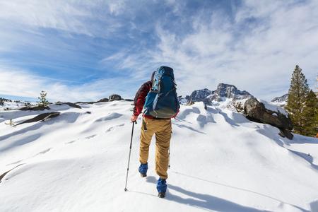 high sierra: Man with hiking equipment walking in Sierra Nevada  moutntains,California,USA