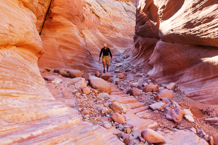slot canyon: Happy Canyon fantastic scene. Unusual colorful sandstone formations in deserts of Utah are popular destination for hikers. Stock Photo