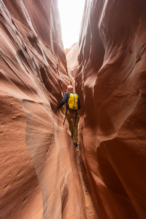 slot canyon: Unusual colorful sandstone formations in deserts of Utah are popular destination for hikers. Stock Photo