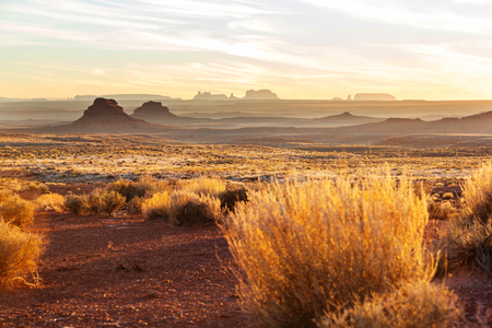 red sky: Valley of the Gods rock formation with Monument Valley at sunrise