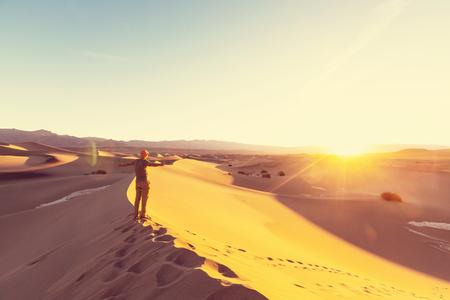 erg: Hiker in sand desert. Sunrise time. Stock Photo