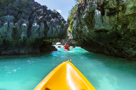 Kayak in the island lagoon between mountains. Kayaking journey in El Nido, Palawan, Philippines. Stock Photo
