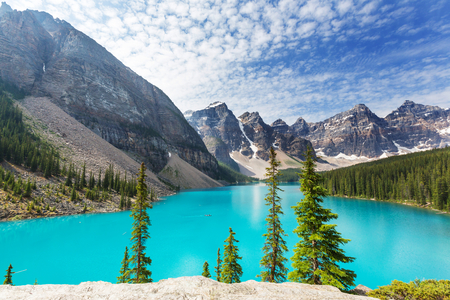 inspiring: Beautiful turquoise waters of the Moraine lake with snow-covered peaks above it in Banff National Park of Canada
