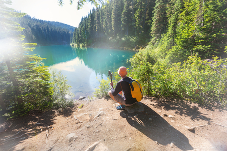 Hiking man in Canadian mountains. Hike is the popular recreation activity in North America. There are a lot of picturesque trails. Stock Photo