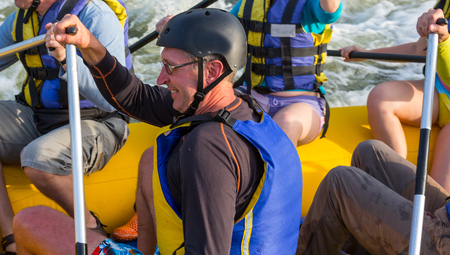 persevere: Rafting team , summer extreme water sport Stock Photo