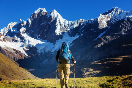 Hiking man with scene in Cordillera mountains, Peru
