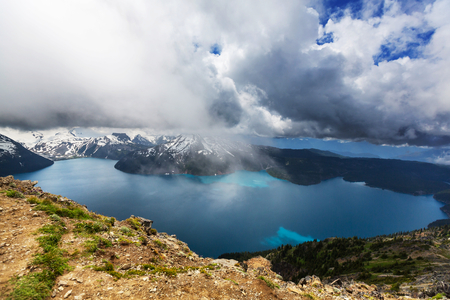 Hike to turquoise waters of picturesque Garibaldi Lake near Whistler, BC, Canada. Very popular hike destination in British Columbia. Stock Photo