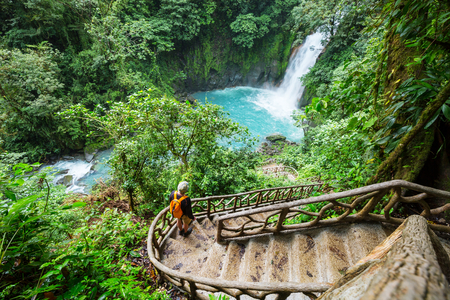 Majestic waterfall in the rainforest jungle of Costa Rica. Tropical hike.