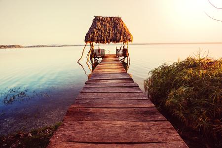 Sunset scene at the lake Peten Itza, Guatemala. Central America. 스톡 콘텐츠