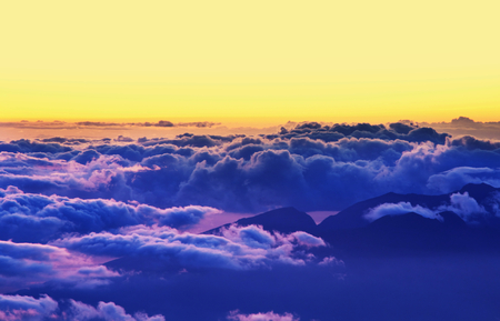 Beautiful view above clouds in mountains Stock Photo