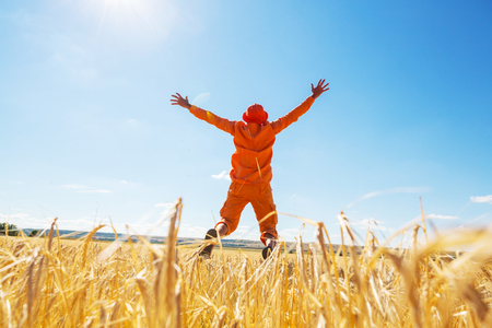 Happy man in yellow wheat field