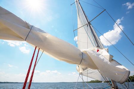 Sailing yacht on big river