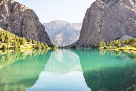 Beautiful serene lake in  Fann mountains (branch of Pamir) in Tajikistan.