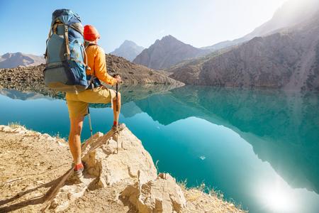 Wanderlust time. Man hiking in beautiful Fann mountains in Pamir, Tajikistan. Central Asia. Stock Photo