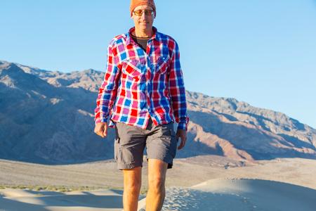 Man in sand desert Stock Photo