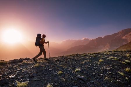 Wanderlust time. Man hiking in beautiful Fann mountains in Pamir, Tajikistan. Central Asia.