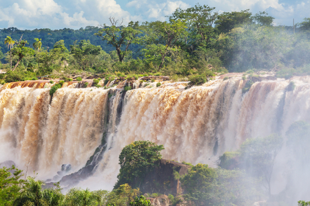 Impessive Iguassu (Iguazu) Falls on the Argentina - Brazil border. Powerful waterfalls in the jungles.