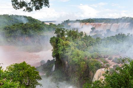 Impessive Iguassu (Iguazu) Falls on the Argentina - Brazil border,  Powerful waterfalls in the jungles.