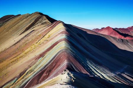 Hiking scene in Vinicunca, Cusco Region, Peru. Montana de Siete Colores,  Rainbow Mountain.