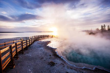 Wooden boardwalk along geyser fields  in Yellowstone National Park, USA Stock Photo