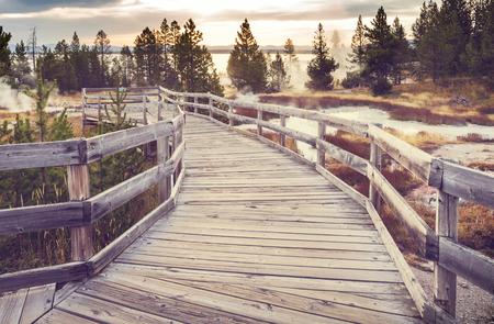 Wooden boardwalk along geyser fields  in Yellowstone National Park, USA 写真素材