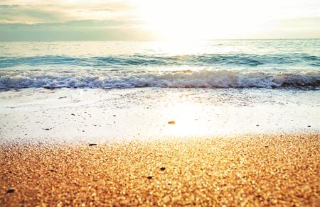 Beautiful sea wave and pebble at sunset.